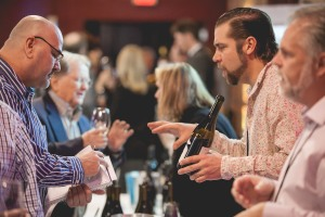 Vintners Pouring for Guests